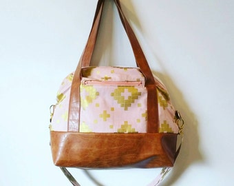 Peach and gold overnight bag with brown faux leather