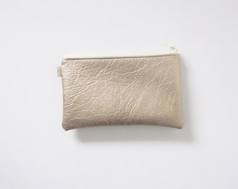 Gold coin purse with floral lining