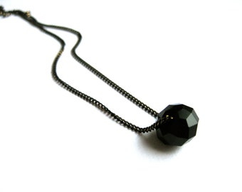 Simple minimalistic necklace with one jet black crystal bead
