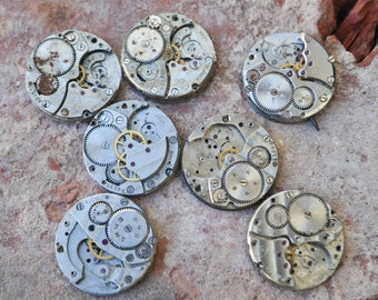 0.9 inch Set of 7 vintage watch movements.