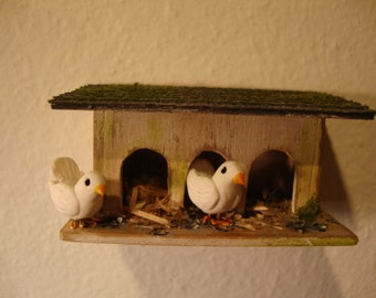 miniature dovecote with white doves