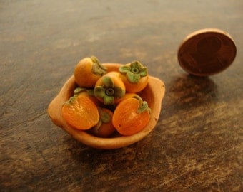 Miniature earthenware bowl with persimmon