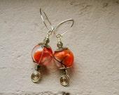 Glass sphere earrings in orange