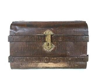 Antique metal tin trunk
