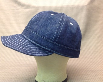 Custom made mechanics cap in indigo denim, soft visor, white topstitching, eyelets, no button. Any size available, fitted or adjustable.