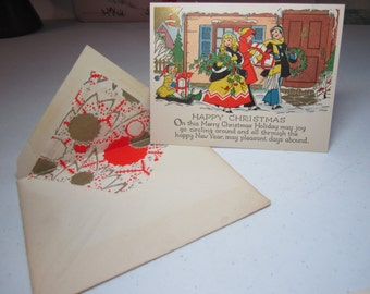 Gold gilded art deco unused 1920's-30's christmas card children in winter clothes carry gifts,wreath, holly berry, sled, deco lined envelope