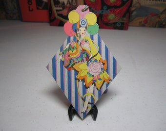 Unused very art deco 1920's die cut Hallmark bridge tally deco lady in colorful dress with stylized deco flowers cloche hat, holds balloons