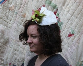 White lace moss and orchid fascinator