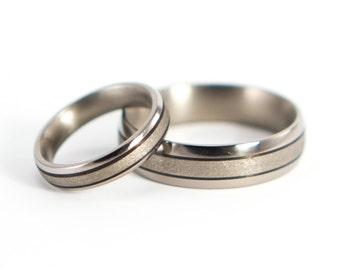 Set of two sandblasted titanium and carbon fiber wedding bands. Modern rings. Water resistant, very durable and hypoallergenic. (00300_4N7N)