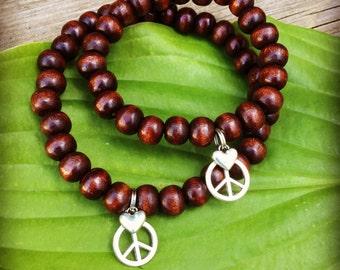 Friendship partner matching meditation mala bracelets in dark brown wood with peace and heart charms