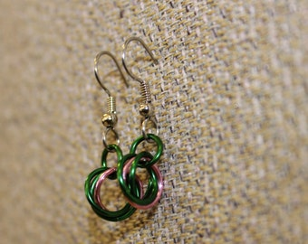 Green and pink enameled copper mobius flower earrings