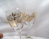 Gold and silver hand painted pair of wine glasses