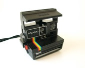 Vintage Spirit Polaroid instant camera with rainbow stripe