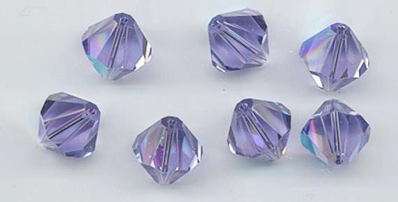 Eight magnificent rare large Swarovski crystal beads: Art. 5301 - 12 mm - tanzanite AB