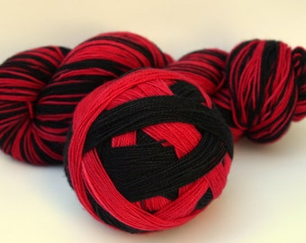 "Self Striping Sock Yarn, Superwash Merino and Nylon Fingering Weight, in ""Ladybug"""