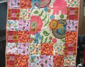 Pink and orange flannel baby quilt