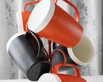 Mixed Orange and Black 5 Piece Set Therm Ware Mugs by David Douglas