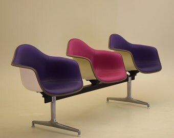 Rare white backed purple and pink dames tandem seating brief issue from Herman Miller