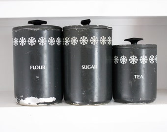 Black flour, sugar, and tea canisters, Miracle Maid Brand