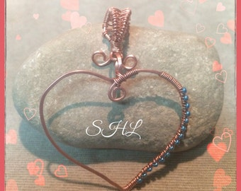 Hand hammered copper heart pendant