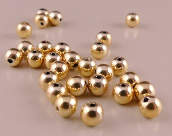 Gold tone spacer beads - 5 mm. 130 pcs.