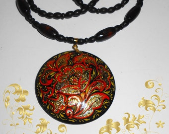 Pendant  in the Russian style khokhloma in handmade circle