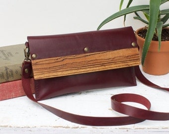 Leather and wood clutch bag with detachable strap
