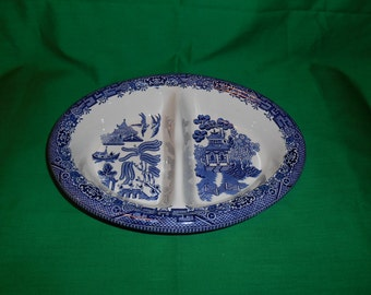 """One (1), 10"""" Oval, Divided Vegetable Bowl, from Churchill, in the Willow Blue, English Pattern."""