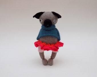 Tan Woollen Pug  -  Handmade woolly plush pug wearing blue pullover, pink felt pants and a bright red skirt.