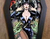 Elvira, Mistress of the Dark in coffin framed print.