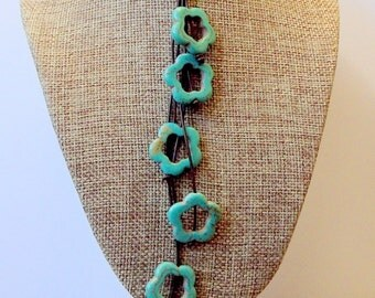 Dangling Flowers-Turquoise Dyed Magnasite Flowers On Leather 20 inch Cord with 925 Closure-