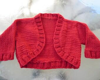 Hand knit Christmas red baby girl shrug