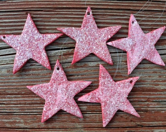 Five pink stars Christmas ornaments