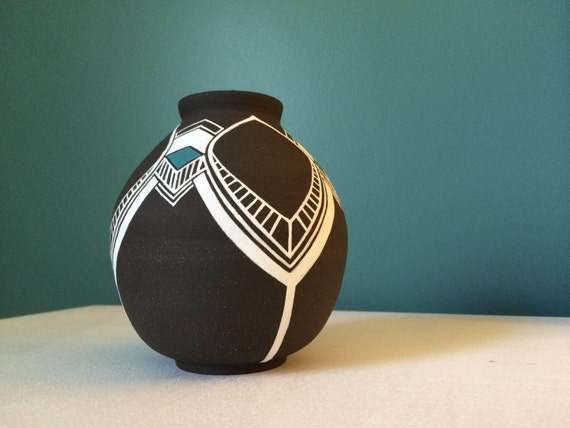 Small black clay pot