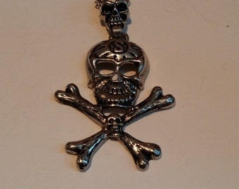 ON SALE Skull and cross bones necklace silvertone