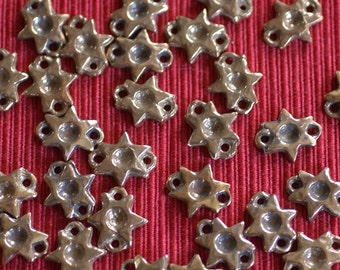 Six Reproduction Medieval Star Mounts