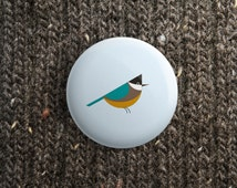spring button with big tit (pinback / magnet / mirror )