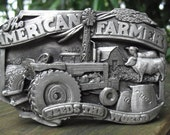 """Vintage Pewter Belt Buckle """"The American Farmer Feeds The World"""" Made By Siskiyou Buckle Co., Inc 1983"""