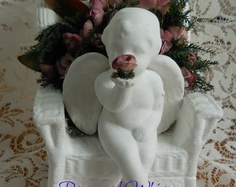 White Cherub sitting in Wicker Chair - Florals
