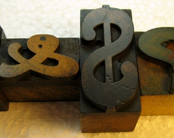 4 pieces of vintage letterpress wood type punctuation.  Beautiful old type with great patina