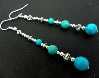 A pair of pretty tibetan silver & turquoise  bead long dangly earrings.