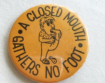 a closed mouth gathers no foot pinback button