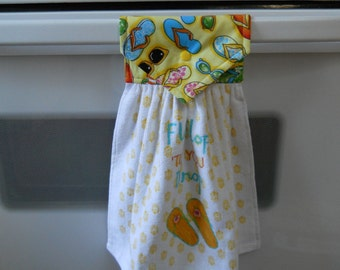 FIP FLOPS on a  lovely hanging towel with snap over top to conviently hang where a towel is needed.