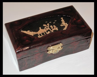Chinese lacquer jewellery box with cork carving feature on lid.