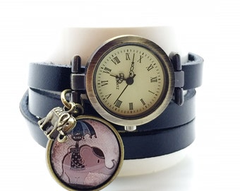 multi link leatherwrist  watch with cabochon