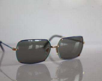 Vintage Polaroid Gold, Blue, Light Blue Frame, Rectangular  Gray Polarizing Lenses. POLAROID  FACES 4757H. Collectible.