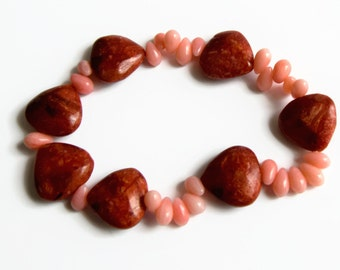 Coral beaded stretch bracelets, orange coral heart bracelet, UK shop.