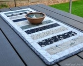 Quilted table runner Wordsmith Janet Clare Navy and Cream wildlife nature modern home decor neutral earthy fabric patchwork table runner UK