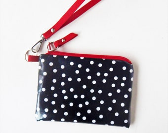 Coin purse, key ring wristlet in laminated, water resistant fabric in polka dots and red trim.