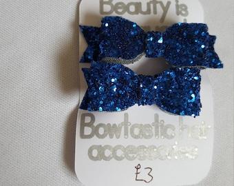 Two tiny royal blue glitter hair bow clip